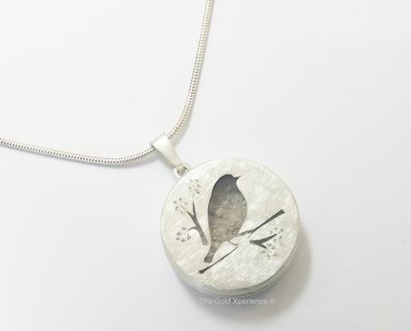 uitvaart1001lichtjes assieraad-zilver-herinnering-vogeltje